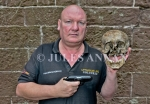Andy Jones curator of The Crime Through Time Collection at Littledean Jail holding an original and well used Walther PPK hand pistol   and skull of a  the Ustacha -Black Legion officer would have been executed by the Serbian partisans at or around the time of liberation Skull remains of a former Ustacha militia- Black Legion officer, who had been severely beaten and then executed with his own Walther PPK hand pistol through the back of his head with a 7.65 mm calibre bullet, the entrance and exit holes being clearly evident ., Andy Jones curator of The Crime Through Time Collection at Littledean Jail holding an original and well used Walther PPK hand pistol   and skull of a  the Ustacha -Black Legion officer who had  been executed by the Serbian partisans at or around the time of liberation Skull remains of a former Ustacha militia- Black Legion officer