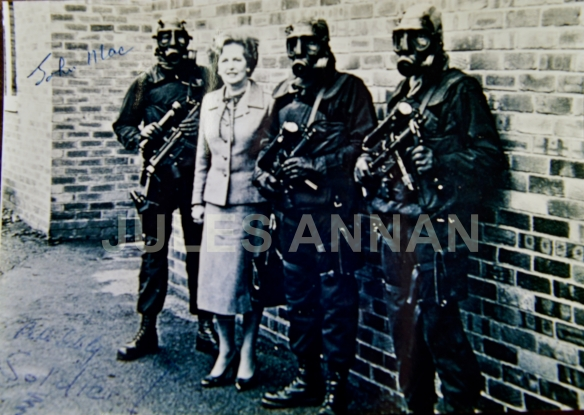 "AN EXCEPTIONALLY RARE  JOHN McALEESE HAND SIGNED ORIGINAL PHOTOGRAPH (SIGNED AS JOHN MAC ) . ALSO SIGNED BY PETE WINNER (AS SOLDIER I ) … AND PETE SCHOLEY . THE PHOTOGRAPH SHOWS THE THEN PRIME MINISTER – MARGARET THATCHER WITH  THREE UN-NAMED MEMBERS OF THE SAS  OUTSIDE THE SAS ""KILLING HOUSE"" IN 1980 SHORTLY AFTER THE IRANIAN EMBASSY SIEGE"