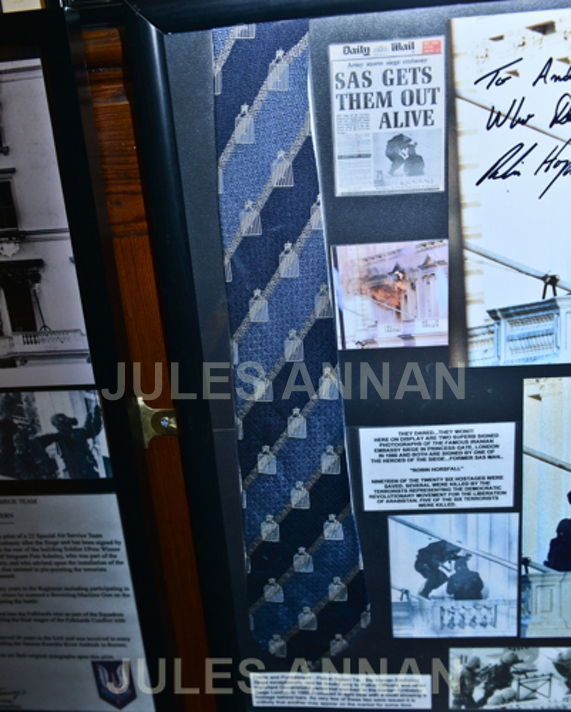 "A rare Princess Gate issued commemorative tie to those involved  during the Iranian Embassy Siege, here on display at the SAS Who Dares Wins "" CRW ""         ( ""Counter Revolutionary Warfare "" )  Exhibition at LittleDean Jail"