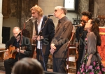 Alabama 3 perform an accoustic song to Bruce Reynolds  inside the church  at   Bruce Reynolds the Great Train Robbery masterminds funeral, London, UK