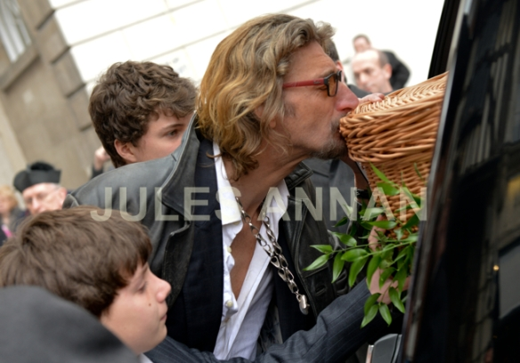 Nick Reynolds kisses his father, Bruce Reynolds coffin as it leaves  the church  at   Bruce Reynolds the Great Train Robbery masterminds funeral, London, UK