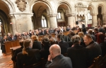 Mourners including Ronnie Biggs, Nick Reynolds and his sons inside the church  at   Bruce Reynolds the Great Train Robbery masterminds funeral, London, UK