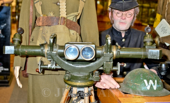 World War 2 FANY ( First Aid Nursing Yeomany) uniform on mannequin displayed along with an original WW2   anti aircraft binocular gunsight on tripod now on display to the public here at the Crime Through Time Collection at Littledean jail, Gloucestershire