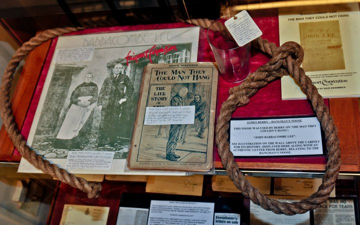 THE ORIGINAL HANGMANS NOOSE HERE ON DISPLAY ALONG WITH OTHER RELATED DISPLAY ITEMS