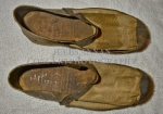 Authentic  homemade male clogs as were worn within the Nazi Holocaust Death Camps.Note these have a stiff leather heel backing and toe protection along with canvas uppers, possibly a higher standard footwear worn by the more senior ranking inmates under control of the Nazi officers ?